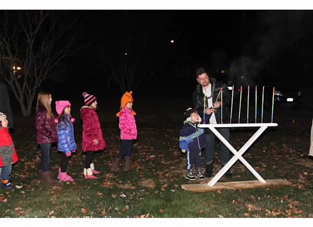 Lighting home-made Menorah during family Hanukah Party at the grandparents'